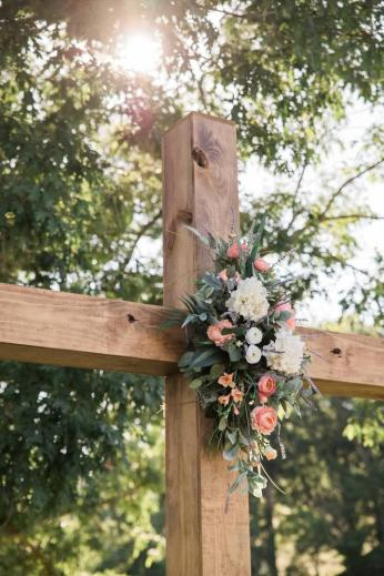 Ceremony cross at Maypop Fields Wedding and Event Venue