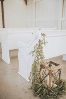 Wedding venue's church pews for ceremony seating