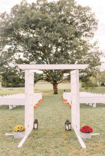 Outdoor ceremony location under grand oak tree at Maypop Fields Wedding and Event Venue